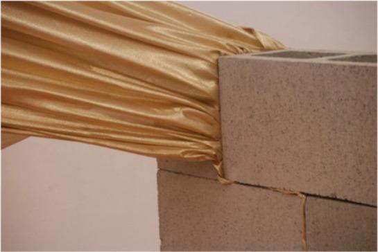 Guadalupe Martinez. Segundo Escape / Second Escape. 2013. Assembled cinderblocks and fabric. Back Gallery Project.